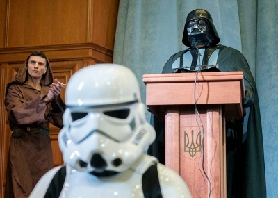 "Activists from the Internet Party of Ukraine, dressed as Star Wars characters, hold a party congress in Kiev March 29, 2014. The party announced that its leader ""Darth Vader"" has submitted documents to the Ukrainian Central Elections Commission to register as a candidate for Ukraine's May 25 presidential election."